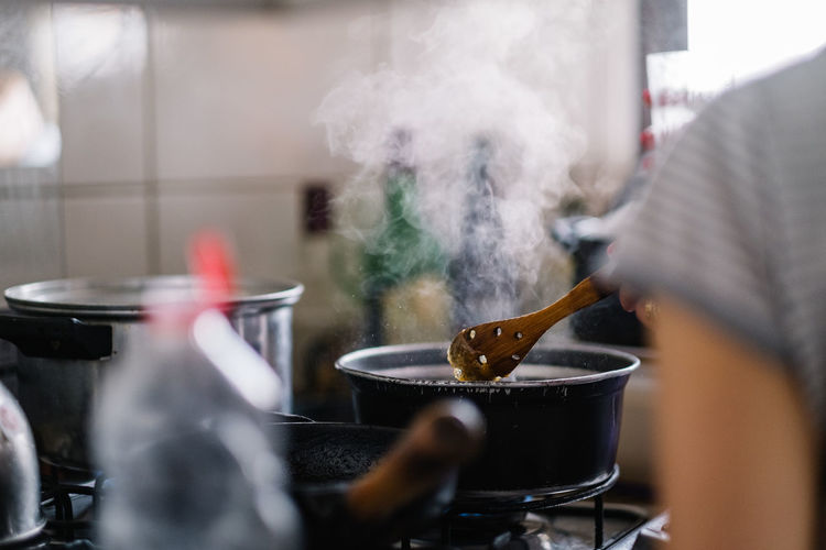 Close-up of meat on barbecue grill in kitchen