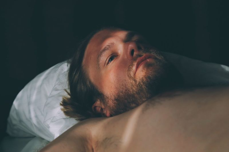 Just woke up Dusk Morninglight Just Woke Up Sleepy Fading Light Full Frame Bed Peaceful Peace And Tranquility Peace And Quiet Morning View Facial Hair One Person Beard Lifestyles Real People Relaxation Lying Down Young Adult Men Bed Headshot Indoors  Portrait Furniture Shirtless Resting Front View Young Men Hairstyle