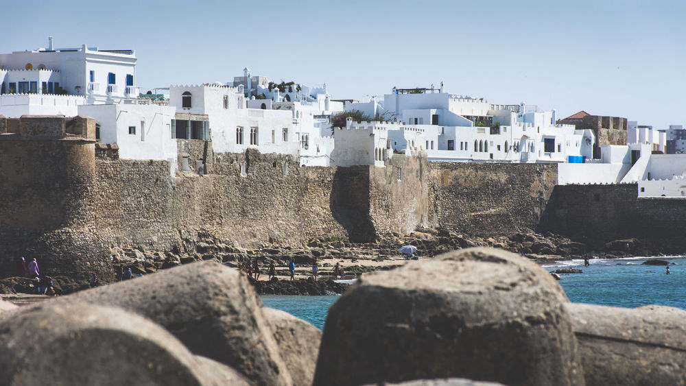 Asilah medina, Morocco Asilah EyeEmNewHere Medina Morocco Morocco Travel Travel Architecture Building Exterior Built Structure City Clear Sky Day Harbor Nature No People Outdoors Rock - Object Sea Sky Water