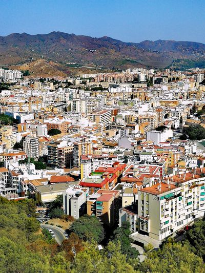 City view of Malaga, Spain from Alcazaba Castle Holiday Destination Mountains And Sky City View  Multi Coloured High Angle View Travel Destinations Tourist Destination Architecture Human Settlement Residential District No People Urban Landscape Housing Settlement House Mediterranean  Malaga Andalucía SPAIN Spain♥ Sky Scenics Country House Residential Building Cityscape Building