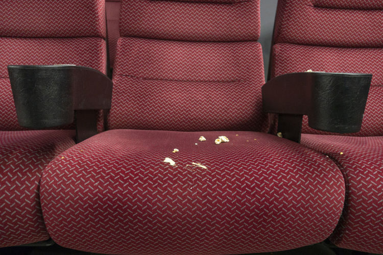 Close-up of dirty seat in theater