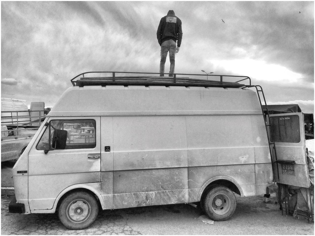 mode of transport, real people, land vehicle, transportation, full length, sky, day, men, outdoors, cloud - sky, one person, people