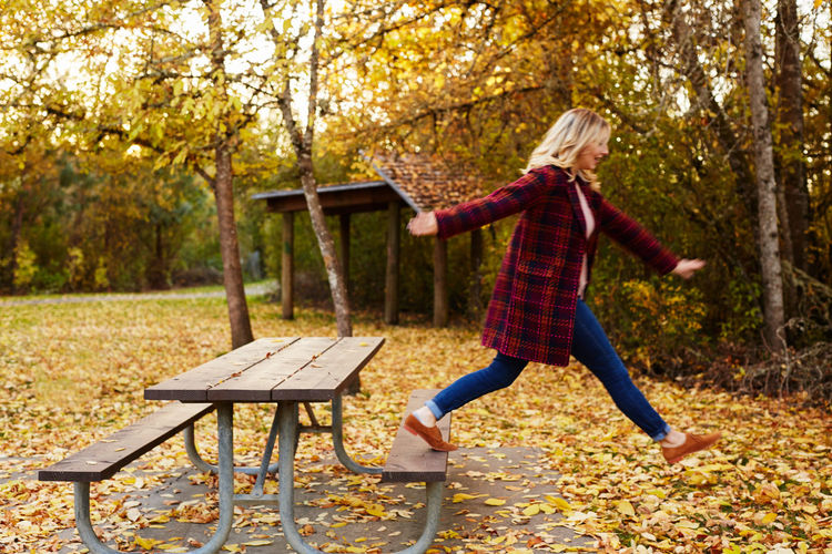 Adult Adults Only Autumn Beauty In Nature Blond Hair Change Day Forest Full Length Fun Gray Hair Leaf Leisure Activity Nature One Person One Woman Only One Young Woman Only Only Women Outdoors Park - Man Made Space People Scarf Tree Women Young Adult