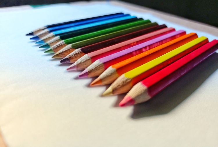 High angle view of colored pencils on table