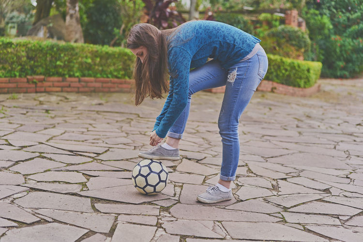 Healthy Lifestyle One Person Full Length Exercising Outdoors Day Jumping Lifestyles Child Adult People Only Men One Man Only Beautiful People Young Women Soccer Life Soccer Player Soccer Field Soccer Blond Hair Young Adult Beautiful Woman Human Body Part One Young Woman Only Adult