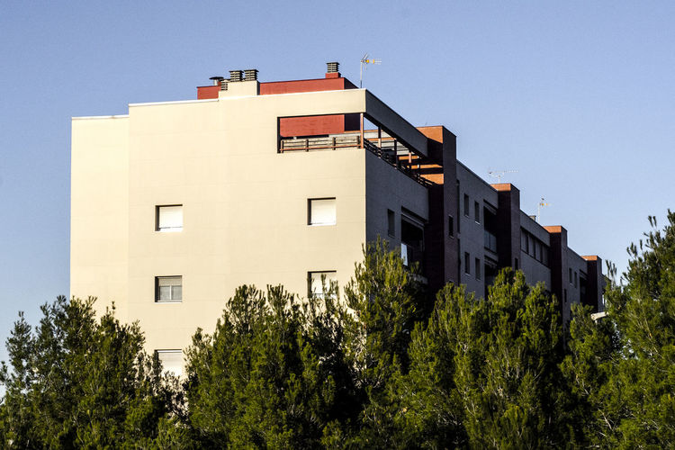 Low angle view of apartment building against sky