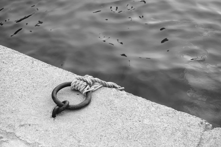 Black & White Iron Quayside Black And White Chain Close-up Concrete Docking Embankment Harbor Iron Ring Metal Monochrome Mooring Mooring Ring Outdoors River Rope Rusty Sea Solid Space For Text Strength Tied Up Water