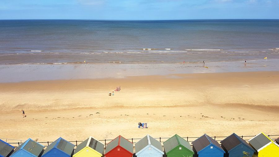 High Angle View Of Colorful Huts At Beach