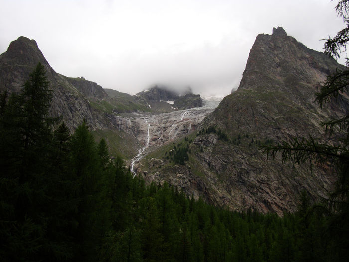 Scenic view of rocky mountains against sky during foggy weather