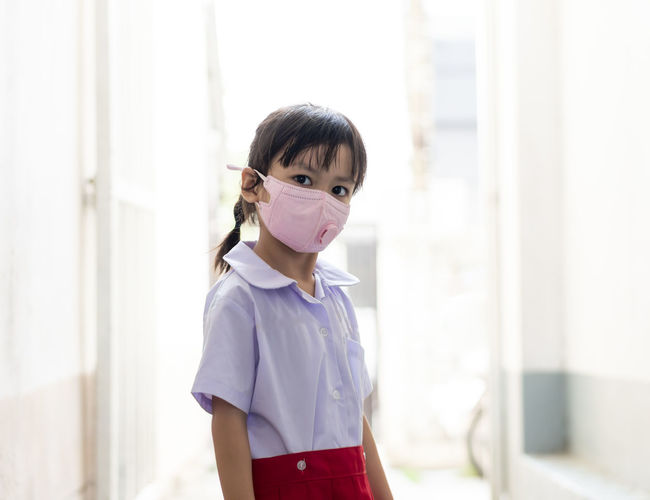 Portrait of girl wearing mask