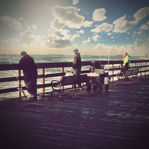 Friends At The Pier..., Railing Sea Water Cloud - Sky Sky Men Rear View Fishing Full Length Sitting Real People Outdoors Leisure Activity Day Jetty Lifestyles Women Nature Fishing Pole