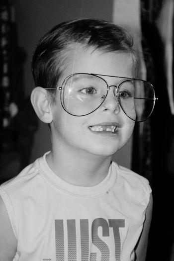 Close-up of cute boy wearing eyeglasses