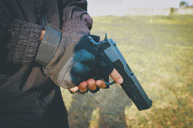 steady hand The Photojournalist - 2018 EyeEm Awards Weapon Handgun Police Force Human Hand Men Holding Gun Crime Close-up Pistol Bullet Machine Gun High-speed Photography Ammunition Target Shooting Terrorism Rifle Photographer Shooting A Weapon