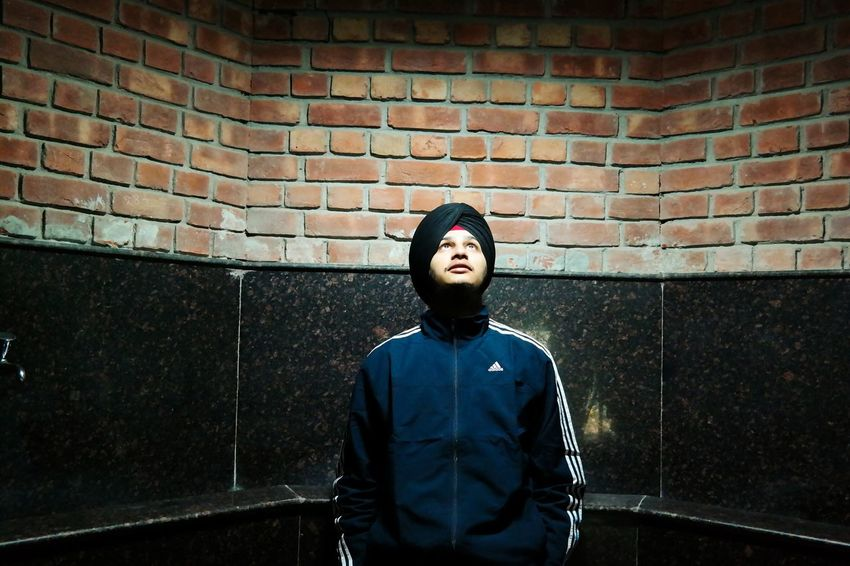 Hope is to see light , inspite of darkness Brick Wall One Man Only Waist Up Only Men Portrait One Young Man Only One Person Adults Only Beard Real People Young Adult People Indoors  Spotlight Lime Light Candid Thoughtoftheday Candid Photography Human The City Light The Human Condition Inner Power A New Beginning