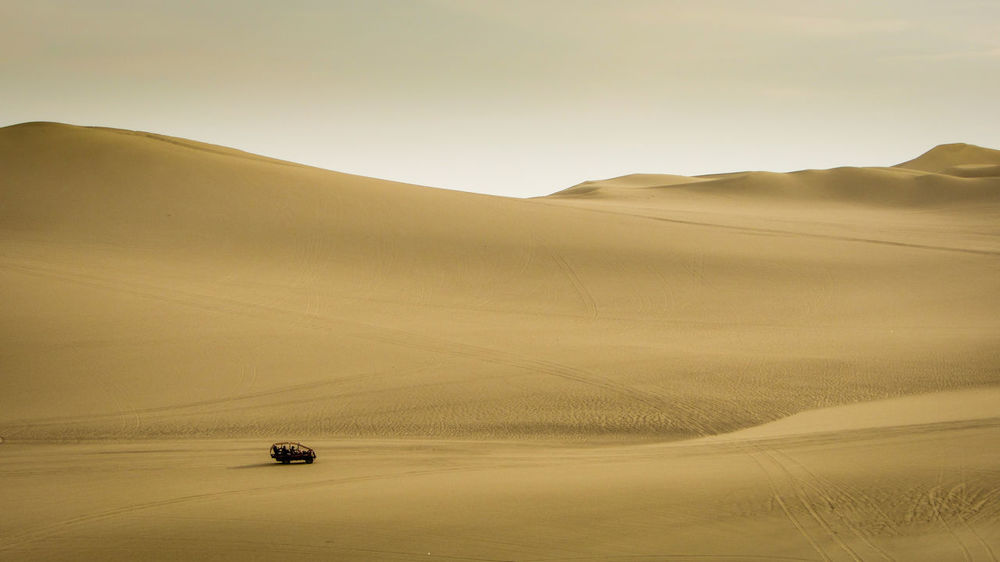 a lonley sand buggy among the dunes of Huacachina. Adventure Arid Climate Car Day Desert Driving Emptyness Environment EyeEm Gallery Finding New Frontiers Huacachina Landscape Landscapes Magic Hour Nature Outdoors Peru Sand Sand Buggy Sand Dune Scenics Sky Travel Destinations Travel Photography Travel The Great Outdoors - 2017 EyeEm Awards