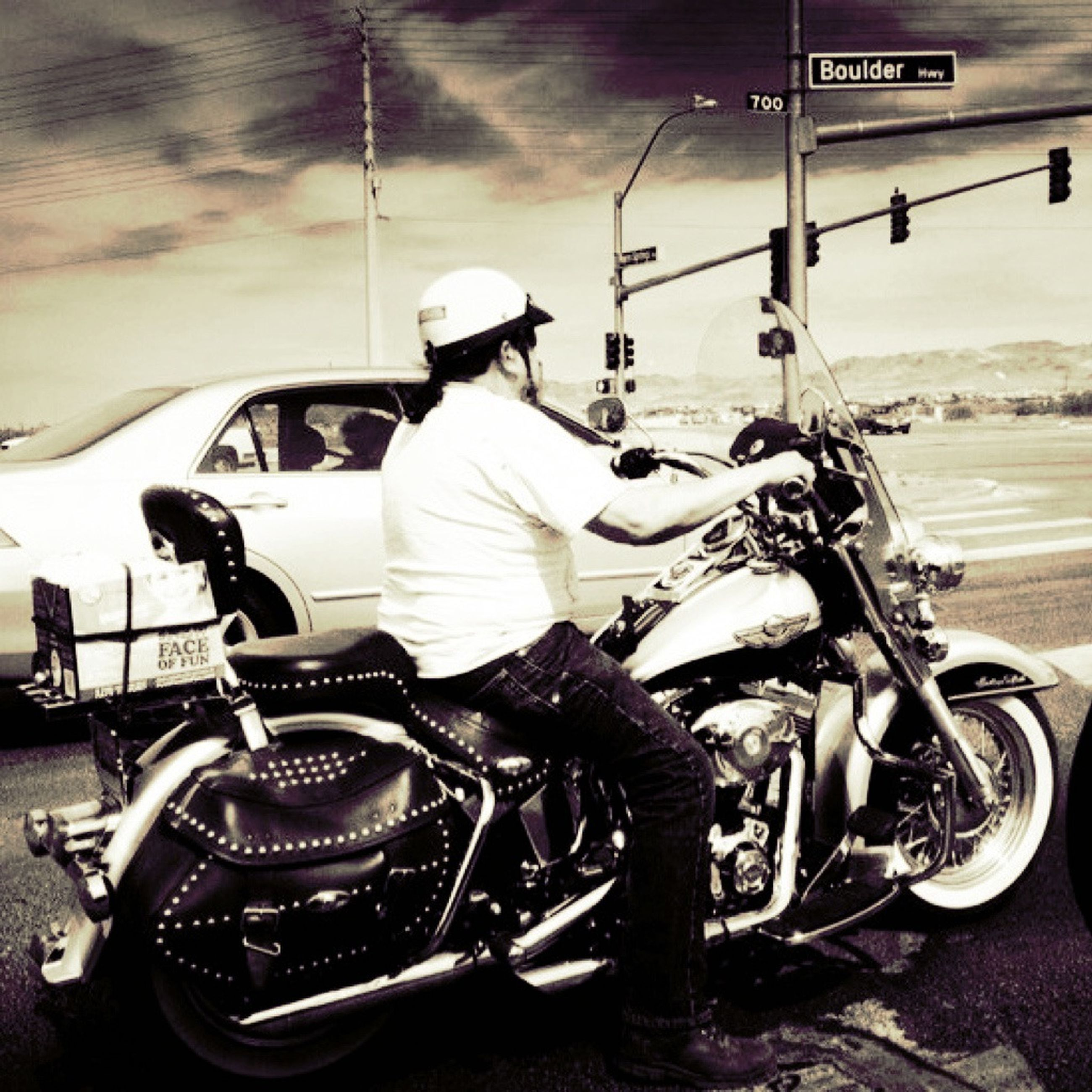 transportation, mode of transport, land vehicle, bicycle, stationary, parking, car, parked, street, travel, road, parking lot, outdoors, day, motorcycle, weather, no people, pole, winter, on the move