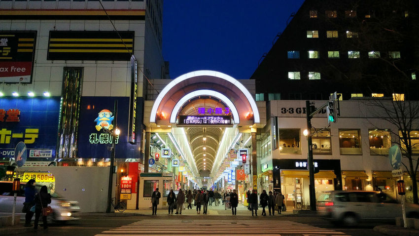 Shopping time Architecture Blue Building Built Structure Capital Cities  City City Life City Street Group Of People Illuminated Leisure Activity Lifestyles Modern Night Outdoors Shopping Travel Destinations Cities At Night Ultimate Japan
