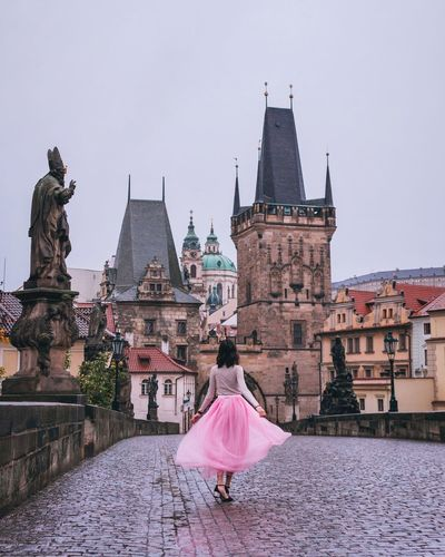 Be. Ready. Living in a fairytale of happily every afters. Full Length One Person Spirituality Architecture Travel Destinations Built Structure Adult Women Young Adult Statue Outdoors Day EyeEm Selects Building Exterior Sky One Woman Only Young Women Prague Prague Czech Republic Charles Bridge Fairytale  EyeEmNewHere EyeEm Gallery EyeEm Best Shots