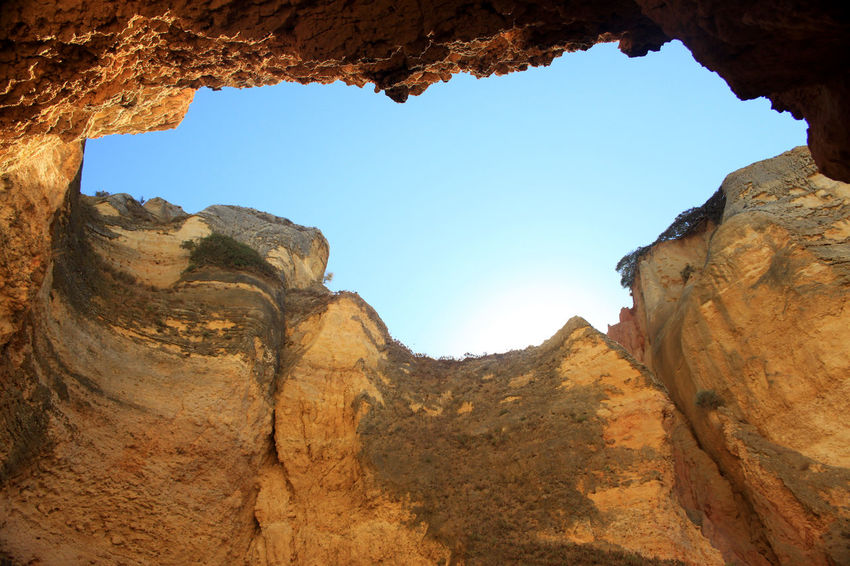 While chilling on the beach whit my friends we noticed this formation right near us, whit a mall climb we found ourselfs in a cliff-hole. amazing moment 2017 Hidden Gems  Lagos Portugal Praia De Dona Ana Beauty In Nature Blue Sky Clear Sky Day Geology Low Angle View Natural Arch Nature No People Outdoors Rock Formation Summer Tranquil Scene