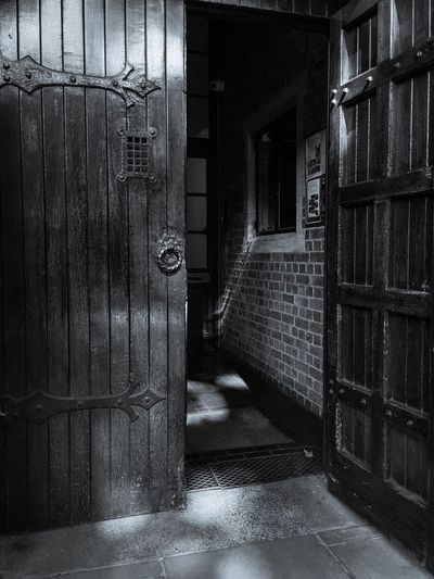 Door Indoors  Built Structure Architecture No People Day Place Of Worship Doorway Wood - Material Metal Hinges Doorhandle Shadow Sunlight Monochrome Contrast Stone Paving Stone Window