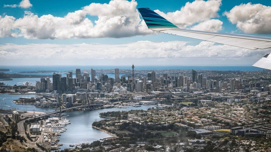 Sydney CBD from a view of this amazing city. The Traveler - 2018 EyeEm Awards EyeEm Best Shots EyeEmNewHere EyeEm Selects EyeEm Sydney Australia Sony Sky Garuda Indonesia City Cityscape Urban Skyline Skyscraper Modern Aerial View Downtown District Business Finance And Industry High Angle View Horizon Urban Sprawl Aircraft Wing Horizon Over Land Airplane Wing Airplane The Great Outdoors - 2018 EyeEm Awards