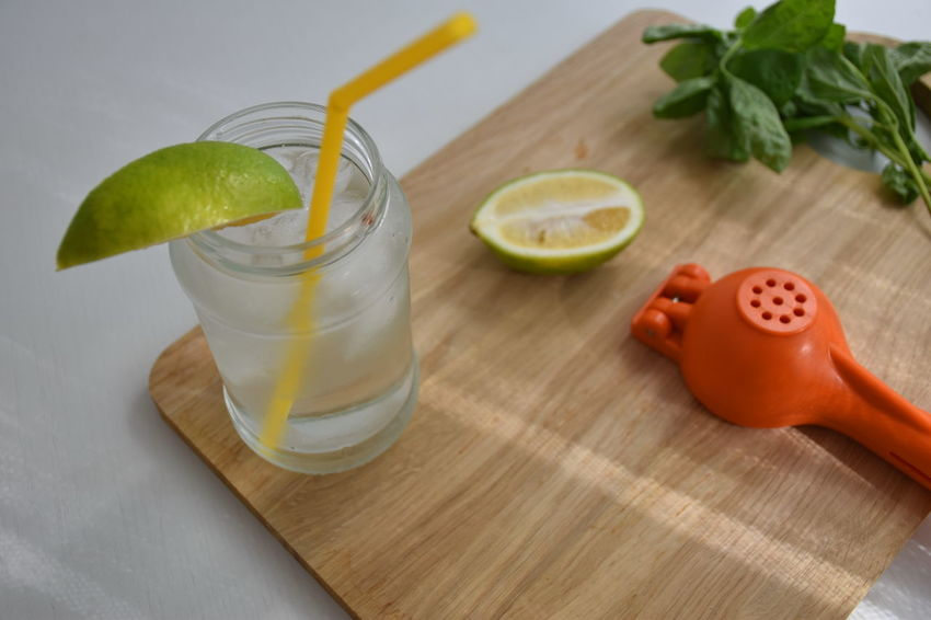 Basil Beverage Citrus Fruit Cutting Board Drink Drinking Glass Drinking Straw Food Food And Drink Freshness Fruit Glass Healthy Eating Herb Indoors  Leaf Lemon No People Refreshment SLICE Still Life Table
