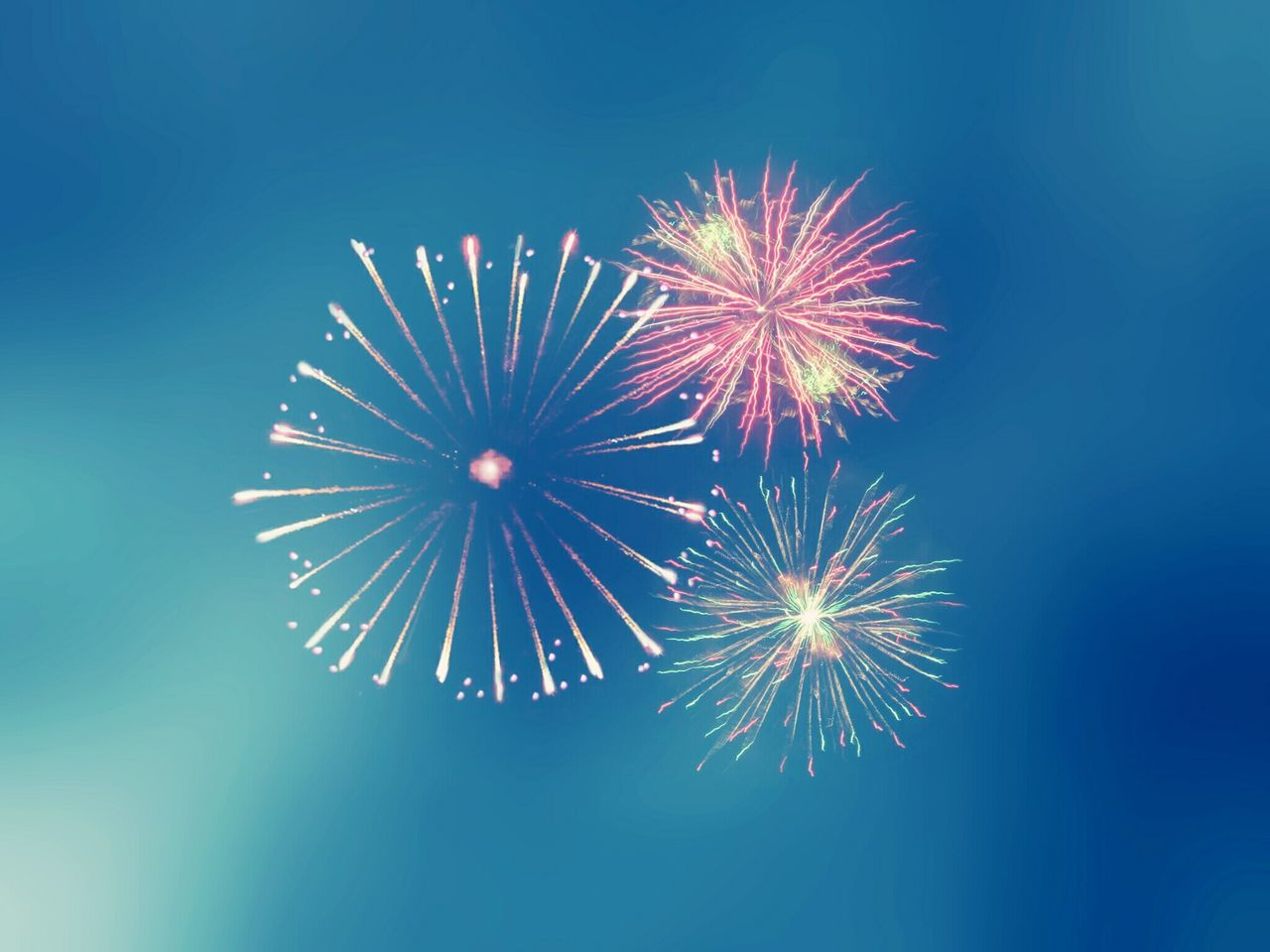 LOW ANGLE VIEW OF FIREWORK DISPLAY IN SKY