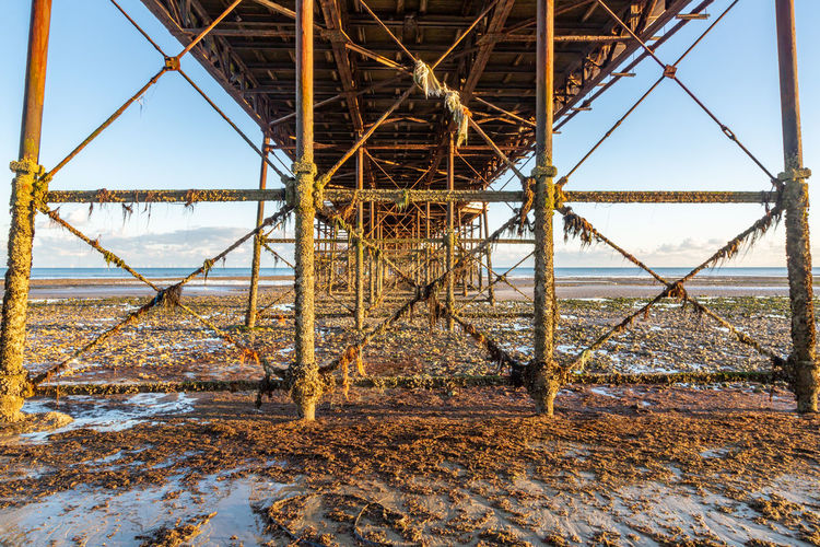 Abandoned pier at beach