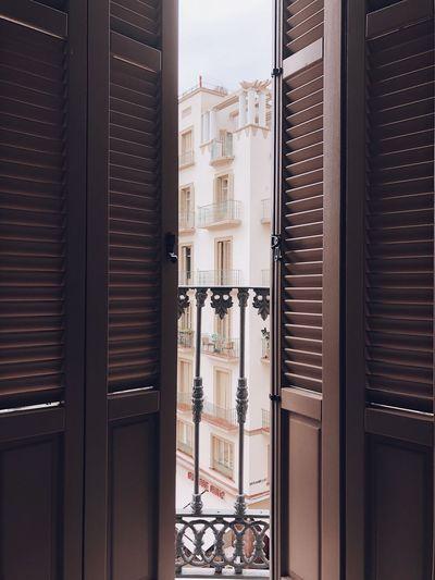 Building seen through open door