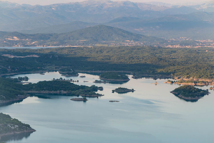 Aerial view of lake with mountains in background