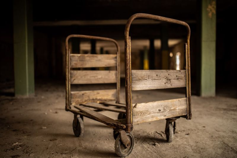 Old rusty cart in abandoned building