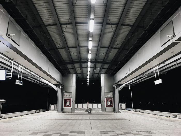 Interior of illuminated railroad station platform