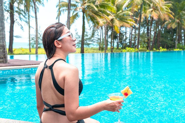 Young woman in bikini swimming pool