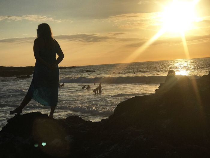 Unlimited horizon Sea Sunset Water Nature Sun Beauty In Nature Horizon Over Water Beach Scenics Sky Silhouette Leisure Activity Real People Lifestyles Sunlight Tranquil Scene Cloud - Sky Outdoors Women
