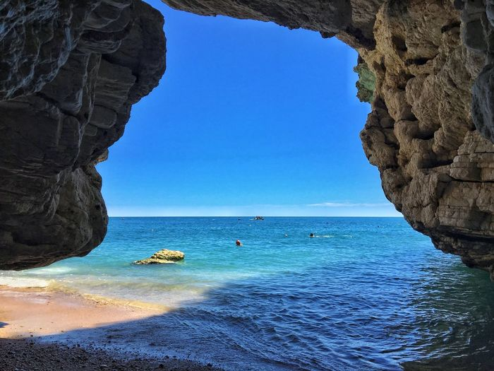 Rock - Object Rock Formation Sea Blue Clear Sky Nature Scenics Beauty In Nature Water Geology Sky Day Horizon Over Water Beach Outdoors Natural Arch No People Salento Puglia Salento Puglia South Italy Puglia Italia Caves