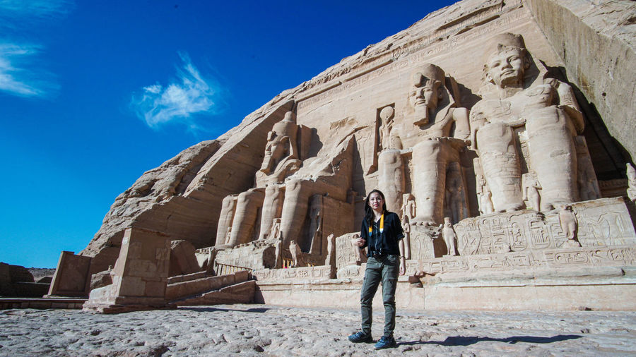 Asian tourist in front of masjestic abu simbel temple of egypt grand beautiful ancient architecture