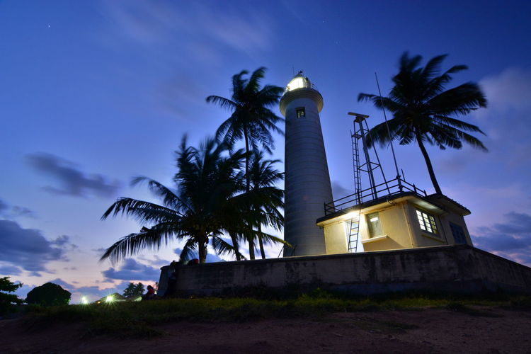 The lighthouse at dusk. Galle. Sri Lanka Architecture Blue Sky Building Exterior Ceylon Dusk Galle Galle Fort Lighthouse Lighthouse_lovers Nature Night Night Lights Nightphotography No People Outdoors Palm Tree Palms Silhouette Sri Lanka Sunset Travel Destinations Tropical World Heritage