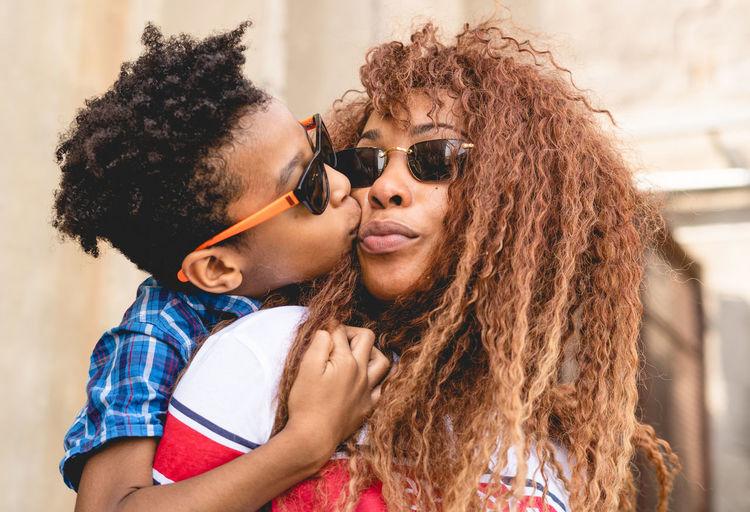 Boy kissing mother on cheek