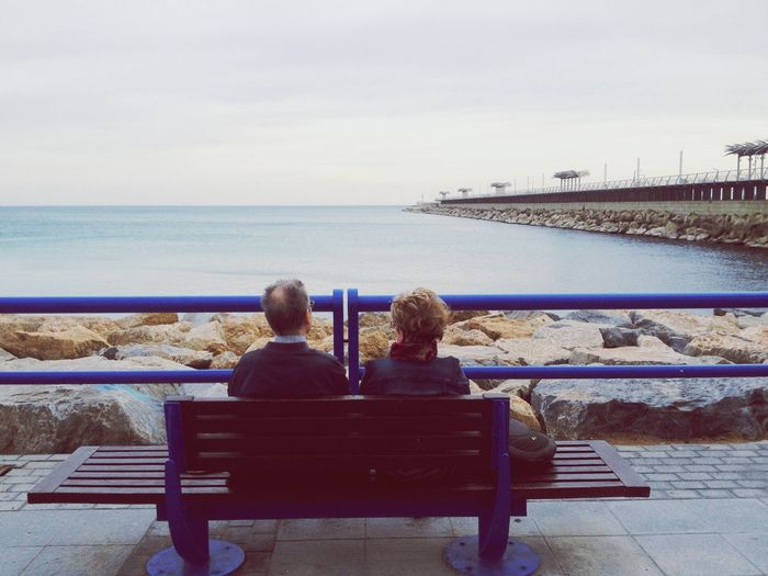 Watching the horizon Sitting Sea Water Rear View Bench Real People Sky Togetherness Lifestyles Bonding Nature Leisure Activity Horizon Over Water Two People Beauty In Nature Full Length Day Scenics Women Old Woman Old Man Romantic Tranquility Peaceful Lost In The Landscape