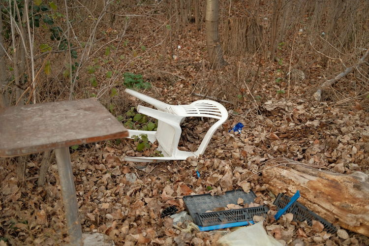 High angle view of abandoned chair on field