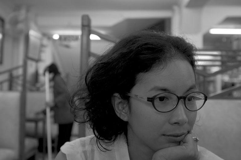 warung life in Java B&w Photography B&W Portrait Beautiful Girl Black And White Photography Bokeh Close-up Fujifilm_xseries Head And Shoulders Headshot Lifestyles Makeportraits Mood Moody Portrait Of A Woman Selective Focus The Portraitist - 2016 EyeEm Awards Diner Cafe Woman Wearing Glasses Booth Table Hand Under Chin