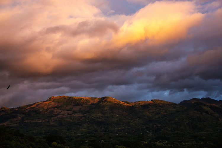 Low angle view of storm clouds over mountains