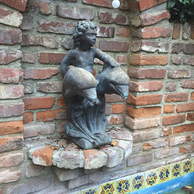 Brick Dolphin Fountain Statue Tarnished Tiles Wall