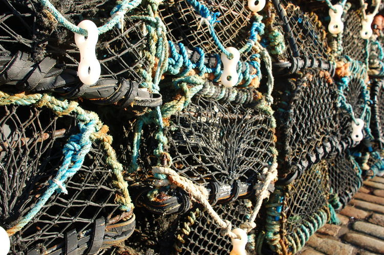 Lobster pots stacked up on the harbour at Mullion Cove in Cornwall Cobbles Fishing Handmade Harbour Lobster Pots Ropes Tackle First Eyeem Photo