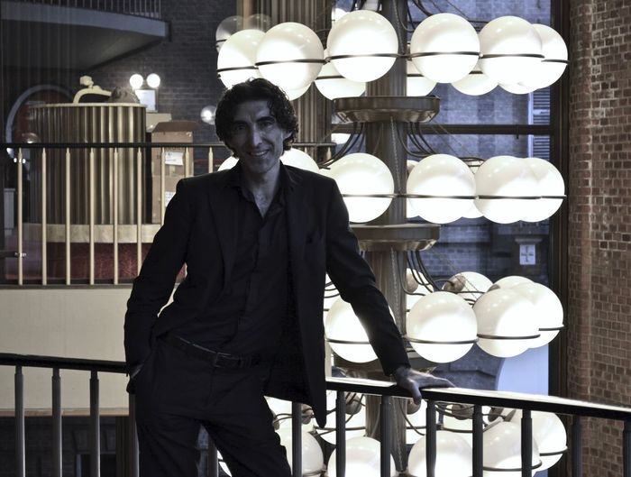 Teatro piccolo riggio, torino. italy. portrait of young man standing against railing