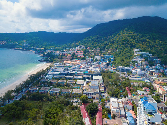 Aerial view of Patong beach, Phuket island and sea in summer, and urban city with blue sky for travel background, Andaman ocean, Thailand. Patong Island Phuket City Hotel Above View Aerial Thailand Sightseeing Beach Summer Wild Tourists Environment Mountain Coastline Shore Water Bay Turquoise Boats Travel ASIA Sky Sea Thai Nature Blue Tourism Tropical Vacation Landscape Outdoor Ocean Holiday Background Architecture Asian  Sand Coast Resort Day Park Buildings Cityscape Downtown Town Skyline Urban