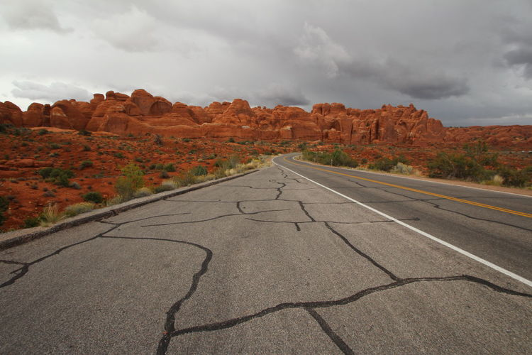 Beautiful nature Arches Cloud - Sky Sky Scenics - Nature No People Nature Environment Road Landscape Direction The Way Forward Transportation Mountain Beauty In Nature Non-urban Scene Day Rock Land Tranquil Scene Rock Formation Rock - Object Outdoors Diminishing Perspective Arid Climate Climate Formation