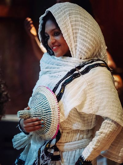 Addis Ababa Ethiopian Photography 🇪🇹 Africa African Ethiopian Ethiopia Tribes Portraits Portrait Photography Portrait Of A Woman One Person Clothing Real People Waist Up Lifestyles Hat Women Adult Close-up Leisure Activity Focus On Foreground Casual Clothing Front View Glasses Three Quarter Length Indoors  Warm Clothing Day Scarf