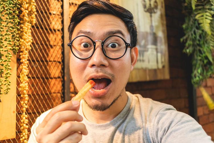 Portrait of man eating food