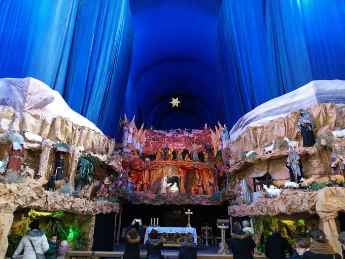 Christmas nativity scene in catholic church, Poznań Christmas Around The World Catholic Catholic Church Curtain Indoors  Celebration Religion Low Angle View Illuminated Large Group Of People Architecture First Eyeem Photo